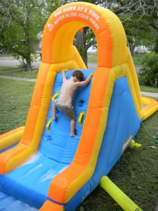 climbing up the splash and spray inflatable
